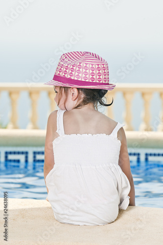 Cute Young Child Sat on the Poolside