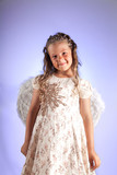 Cute little girl with pigtail hairstyle and angel wings poster