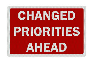 Photo realistic 'changed priorities ahead' sign, isolated on pur