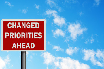 Photo realistic 'changed priorities ahead' sign, with space for