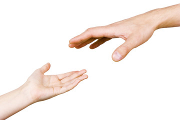 child's hand reaches for the men's hand
