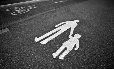 parental guidance concept - pedestrian sign on the  pavement/sid
