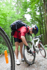 Mountain biking in a forest - bikers on a forest biking trail