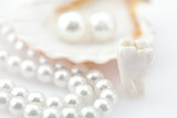 Healthy teeth concept. Real human wisdom tooth and natural pearl