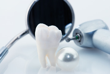 Real human wisdom tooth, natural pearl and dental tools
