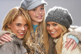 Three Fashionable Teenage Girls Wearing Cap And Knitwear In Stud poster