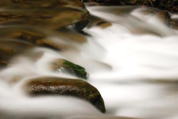 white cascade on the stones