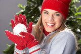 Fashionable Teenage Girl Wearing Cap And Knitwear Holding Snowba poster