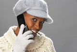 Fashionable Woman Wearing Knitwear And Cap In Studio Using Mobil poster
