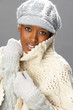 Fashionable Woman Wearing Knitwear And Cap In Studio