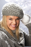 Fashionable Woman Wearing Cap And Knitwear Holding Snowball In S poster