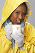 Young Woman Drinking Hot Drink Wearing Yellow Raincaot