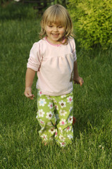 Little blond girl playing