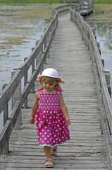 Little blond girl on boardwalk
