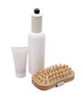 cosmetic set with wooden massager  isolated