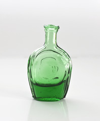 studio captured green bottle on white background