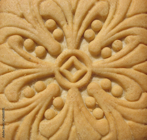 Appetizing rosy biscuits with ornament.