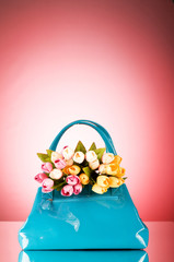 Bag and flowers against the colorful background