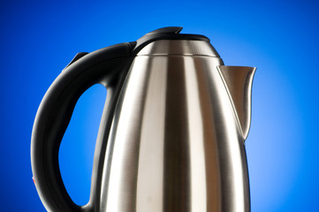 Shiny kettle against the colorful gradient background