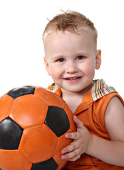 Portrait of baby with ball