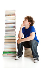 Student sitting close to pile of books on white