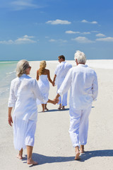 Two Couples Generations Family Holding Hands on Tropical Beach