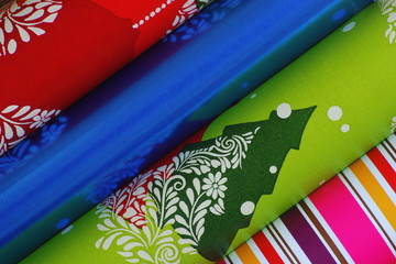 Christmas wrapping paper rolls close-up