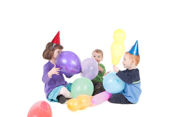 Kids playing with balloons at party