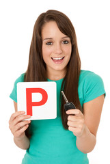 Teenager holding P plate and car key
