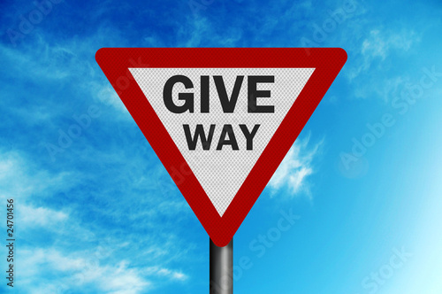 Photo realistic ' give way' sign, against a bright blue sky
