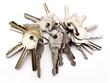Three sets of keys on rings on white