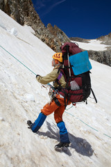 Girl moving down with belay
