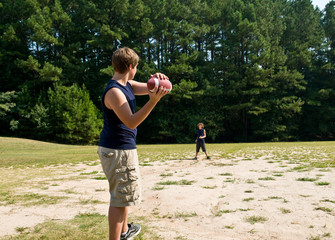boys playing (American) football