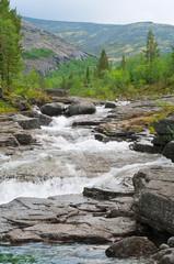 Waterfall cascade in khibins mountain, Russia