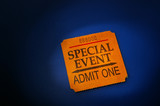 event ticket stub in spotlight, on blue poster