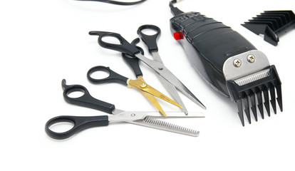 barber shop electric hair clippers and scissors, on white