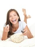 Fototapety Woman watching movie fun