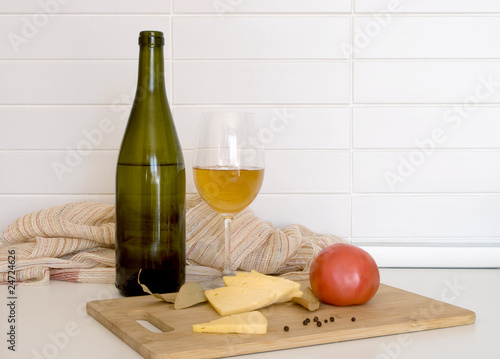 Still-life with cheese and tomato, white wine