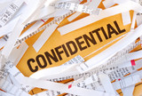 The word Confidential surrounded by some shredded papers poster