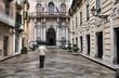 Sicilia - rainy old town in Trapani, anonymous umbrella man