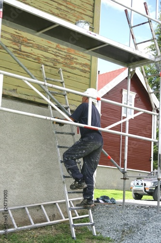Painter in a ladder