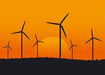 Wind turbine plant over sunset