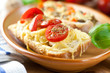 Crostini with cherry tomatoes in a rustic dish