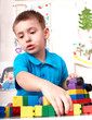 Child playing lego block and construction set.