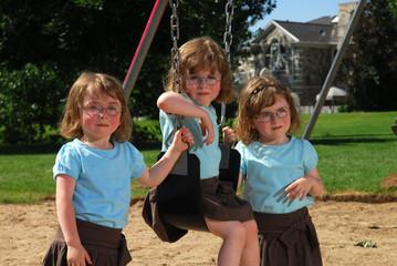 Triplets on the swingset