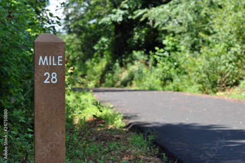 Mile marker on biking and jogging path - 24750880