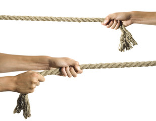 Hands pull a rope