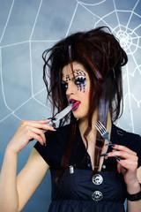 spider girl licking knife