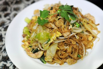 Fried kuey teow (flat rice noodles)