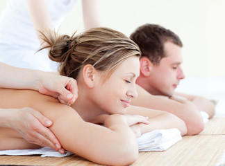 Loving couple having an acupunctre therapy